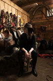 Cowgirl in the stables Royalty Free Stock Photos