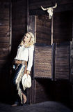 Cowgirl in the stables. At the ranch Royalty Free Stock Image