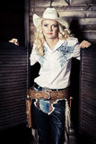 Cowgirl in the stables Stock Images