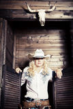 Cowgirl in the stables Royalty Free Stock Photo