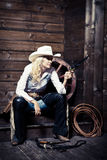 Cowgirl in the stables Stock Image