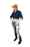 Cowgirl standing. Royalty Free Stock Image