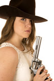 Cowgirl staring at camera holding a large pistol Royalty Free Stock Photography