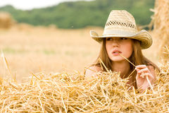 Cowgirl in straw Stock Photography