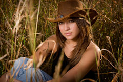 Cowgirl in tall grass Stock Photos