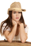 Cowgirl tan hat behind barrel serious Royalty Free Stock Photo