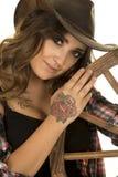 Cowgirl with tattoos wagon wheel lean head close Stock Photo