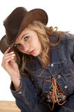 Cowgirl up close lean touch hat Stock Images