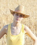 Cowgirl on wheat field Stock Photography