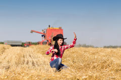 Cowgirl in wheat field Royalty Free Stock Photo