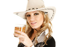 Cowgirl with whiskey Royalty Free Stock Image