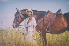 Cowgirl in white dress Royalty Free Stock Image
