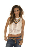 Cowgirl in white lace top stand serious Stock Images