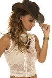 Cowgirl in white top with hat touch brim Royalty Free Stock Image