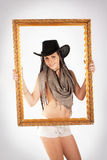 Cowgirl y marco Foto de archivo libre de regalías