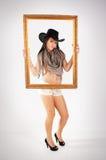 Cowgirl y marco Imagen de archivo
