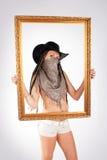 Cowgirl y marco Imagen de archivo libre de regalías