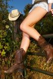 Cowgirlfahrwerkbeine Stockfotografie
