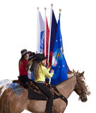 Cowgirls. Holding flags at the opening ceremonies of a rodeo Royalty Free Stock Photos