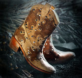 Cowgirls boots. Closeup in studio royalty free stock images
