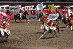 Cowgirls galloping on horseback Royalty Free Stock Photography