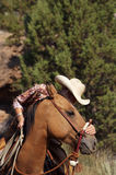 A Cowgirls Heart. Cowgirl Being sweet and petting her horse outside stock photography