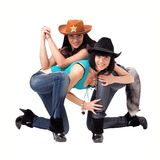 Cowgirls in jeans, boots and cowboy hat Royalty Free Stock Photos