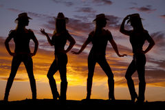 Cowgirls silhouette. A silhouette of a cowgirl in many poses with a beautiful sky behind her Stock Photos