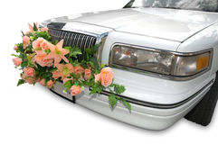 Cowl of a magnificent limousine. Decorated by flowers Stock Photo