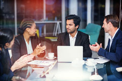 Coworkers applauding colleague at meeting. Coworkers applauding colleague st meeting in office Royalty Free Stock Photography