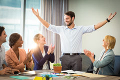 Coworkers applauding a colleague after presentation. In the office Royalty Free Stock Image