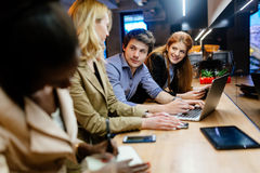Coworkers bonding in pub. Business coworkers bonding in pub after work Royalty Free Stock Image