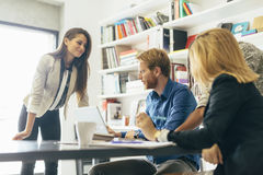 Coworkers brainstorming in office Royalty Free Stock Photo