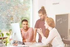 Coworkers brainstorming together. Team of coworkers brainstorming together in modern office Stock Photos
