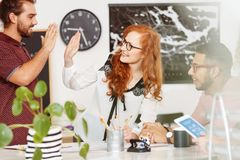 Coworkers brainstorming together. Team of coworkers brainstorming together in modern office Stock Images