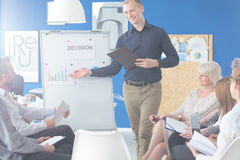 Coworkers on a briefing. Team of coworkers on a briefing led by their colleague Stock Photos