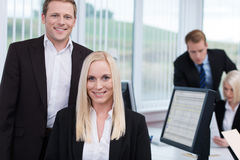 Coworkers in a busy corporate office Stock Photo