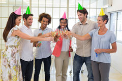 Coworkers celebrate success with champagne and a party Stock Image