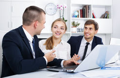 Coworkers chatting about business project Stock Image