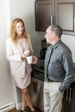 Coworkers on coffee break. Man and women having conversation in office coffee break area royalty free stock image