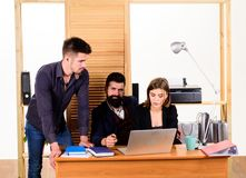 Coworkers communicate solving business tasks. Working together. Managing process. Working in male dominated job. Woman. Attractive lady working with men royalty free stock image