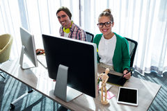 Coworkers on computer. In office Royalty Free Stock Photos