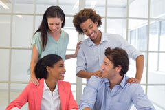 Coworkers congratulating and praising each other Stock Photography