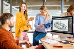 Coworkers designing a car model royalty free stock photography