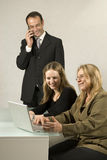 Coworkers at Desk Royalty Free Stock Photography