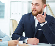 Coworkers discussing project in conference room. stock image