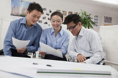 Coworkers discussing project in the office, looking down Stock Image