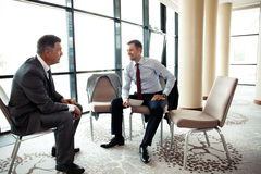 Coworkers discussing project in room Stock Photography