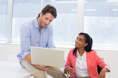 Coworkers discussing work together Stock Image