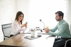 Coworkers distracted by technology Royalty Free Stock Photo